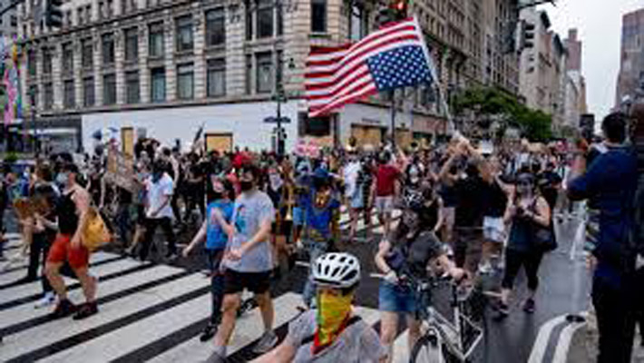 Protesters flood streets in huge, peaceful push for change