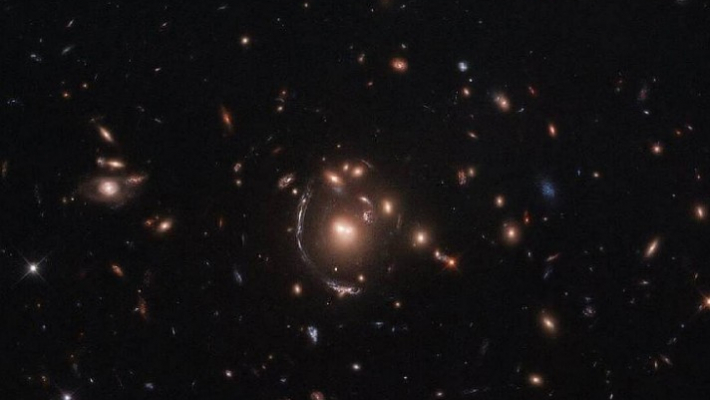 Astronomers discover dozen quasars warped by naturally occurring cosmic 'lens'