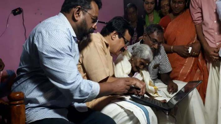 Karthyayani Amma gets laptop as gift after topping literacy exam
