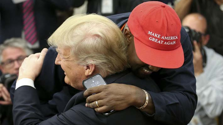 Kanye West hugs Trump, muses on presidential run