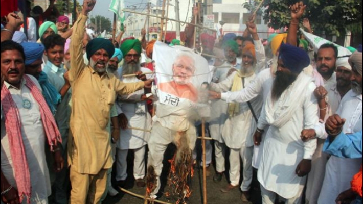 Farmers hold protests across Punjab over new farm reform laws, burn effigies of PM