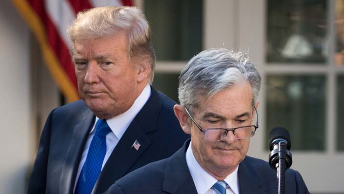 America's central bank raises lending rates for 4th time this year, defies Prez Trump