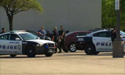2 Dallas police officers wounded in shooting outside store